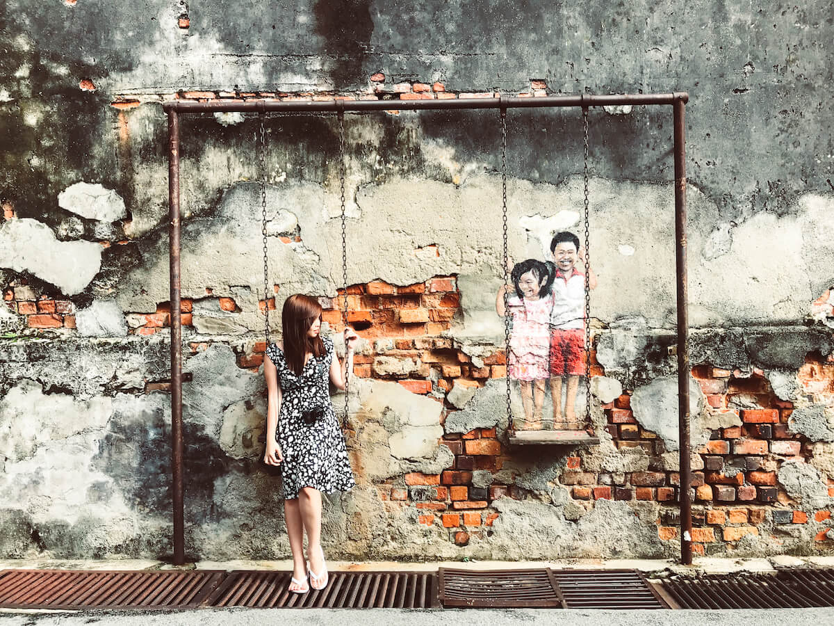 best Penang street art in GeorgeTown Penang Malaysia - Brother and sister on a swing