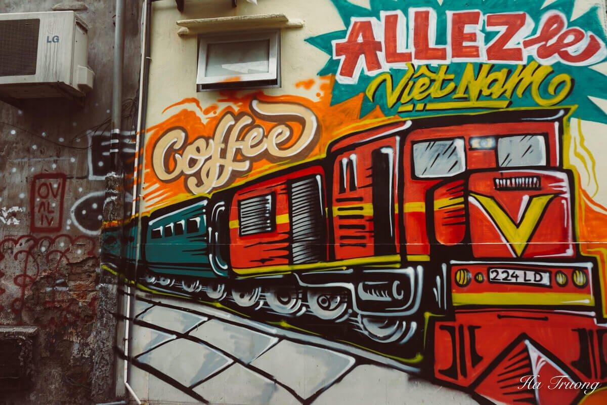 Hanoi train coffee graffiti