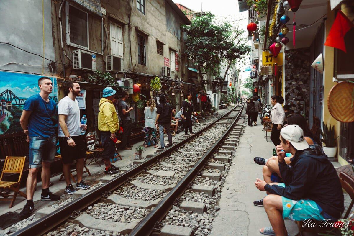 people are waiting at Hanoi train street Vietnam