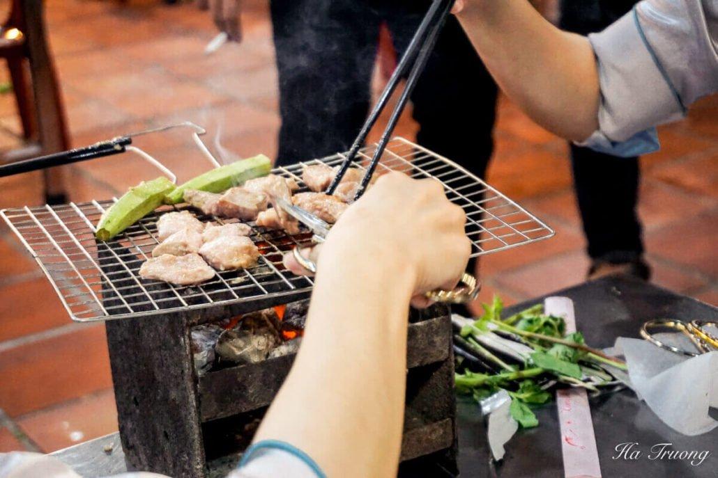 street food at night Ho Chi Minh city Vietnam.