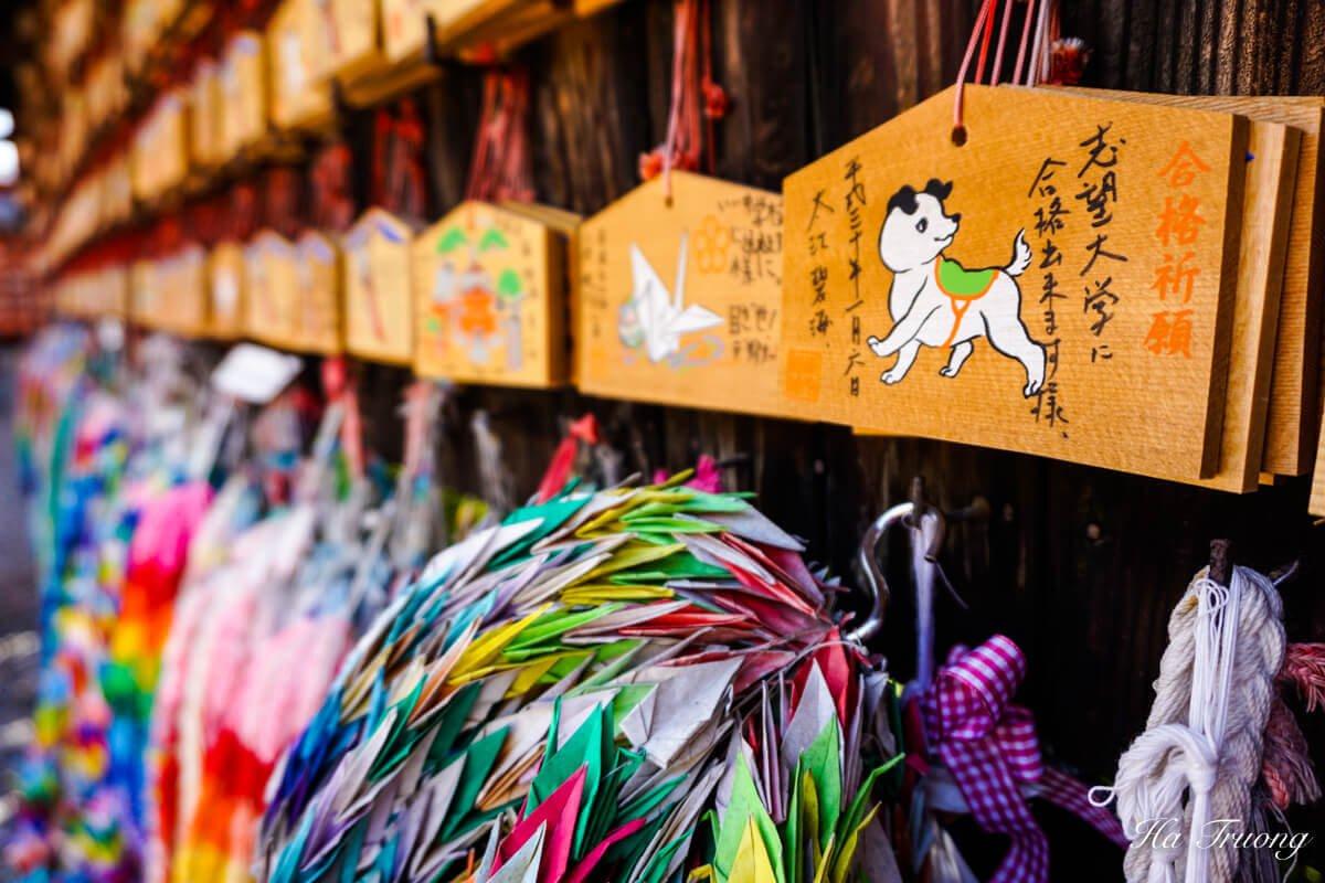 praying cards fox statue Kyoto shrine Japan
