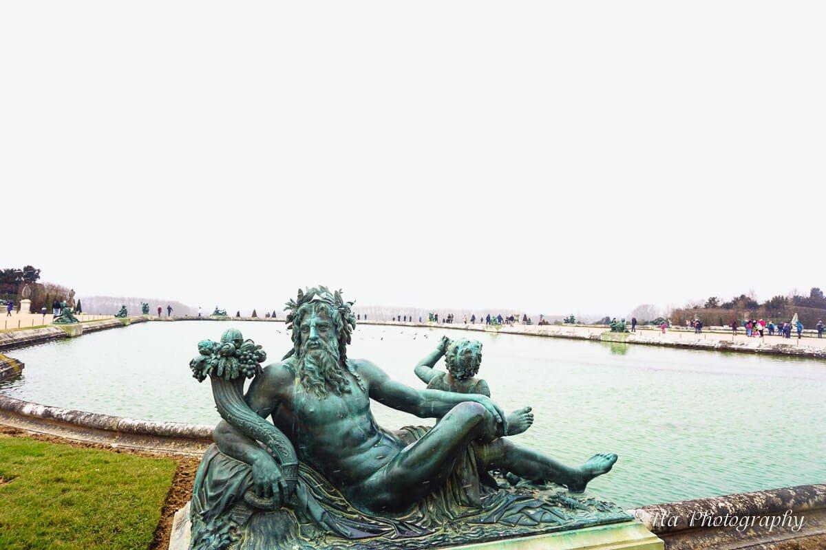 Palace Versailles garden statue France.