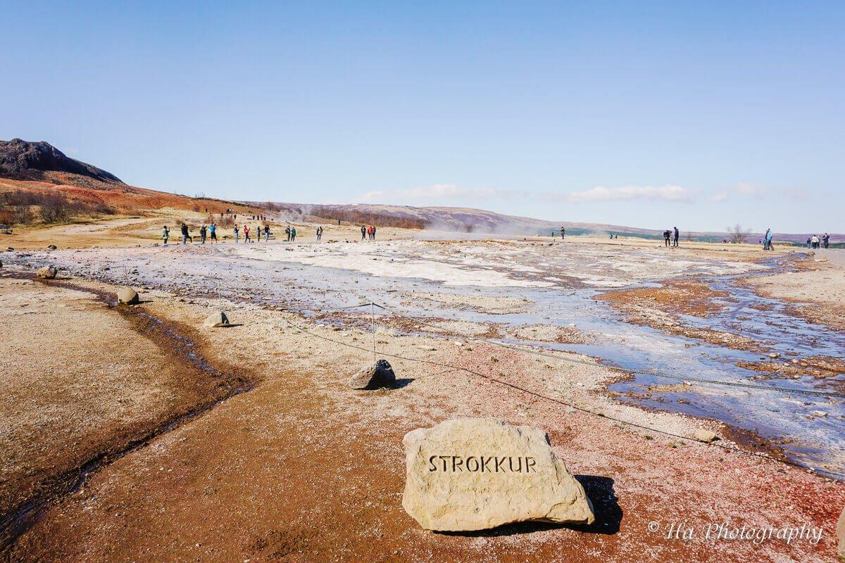 Strokkur sign Geysir Iceland.